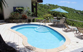 Sculpted pool with lounge areas and alfresco dining