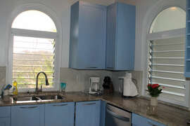 Arched louver windows in kitchen
