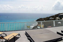 Upper level deck features the hot tub with views of the Caribbean Sea.