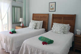 Twin beds in guest bedroom can be made as King bed