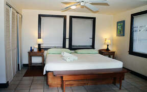 Well appointed and comfortable bedroom with fan and closets