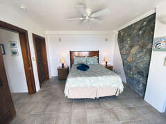 Spacious Bedroom with native rock walls