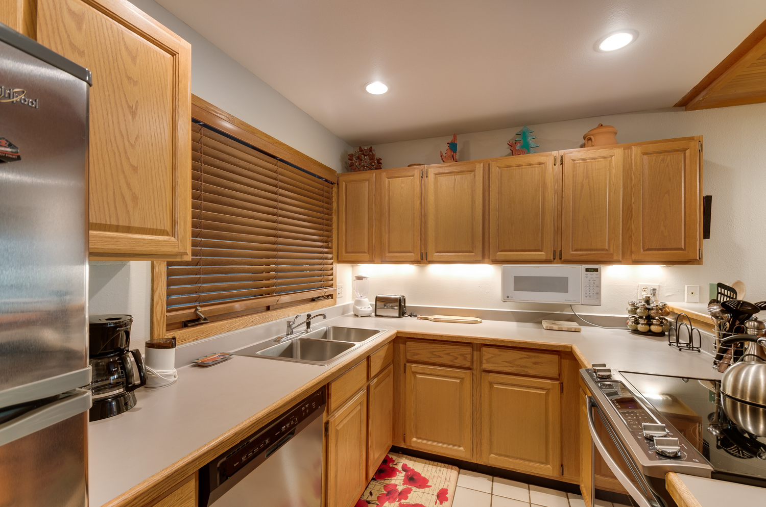 Kitchen with wood cabinets and light countertops