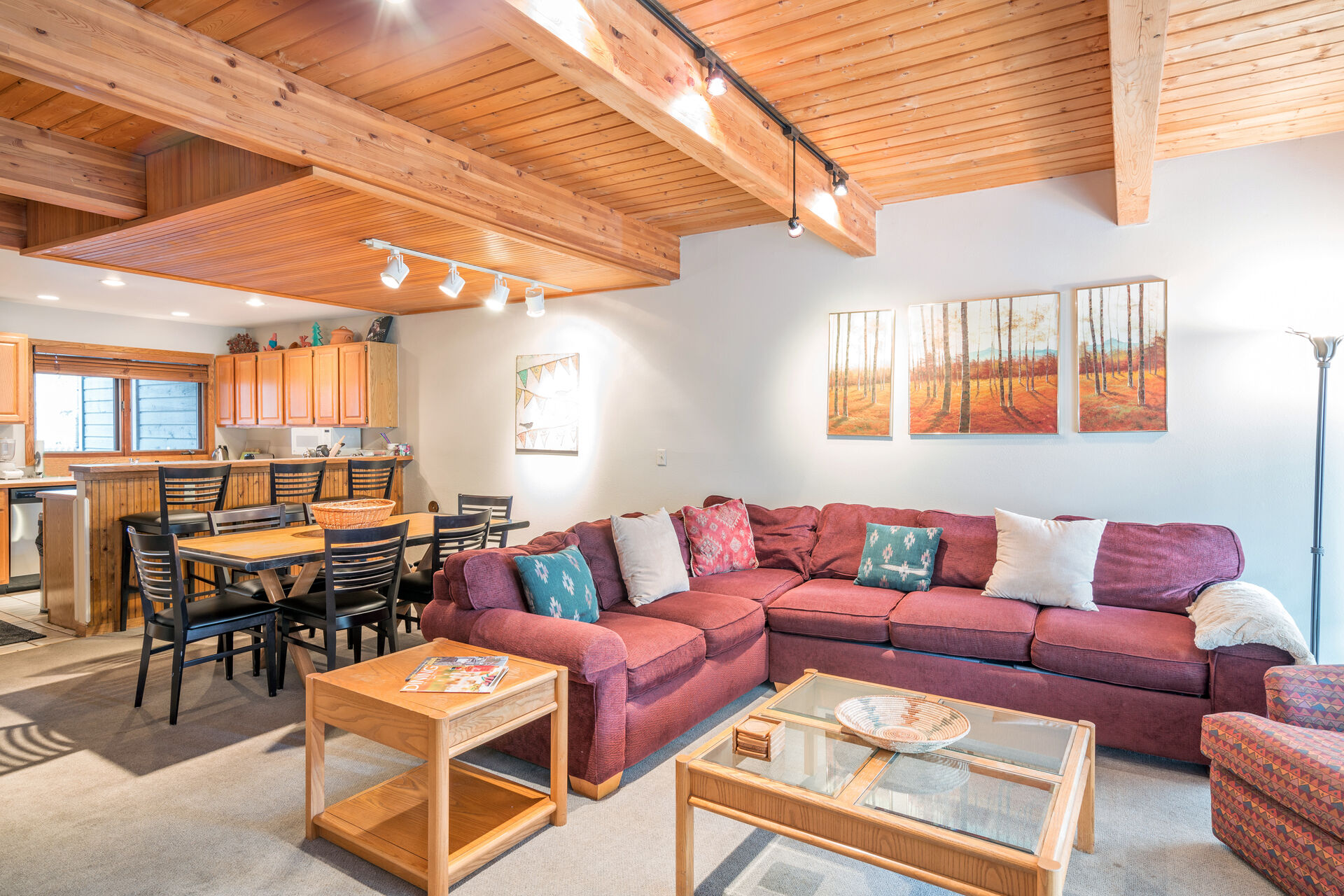 Spacious living and dining room with wood ceilings
