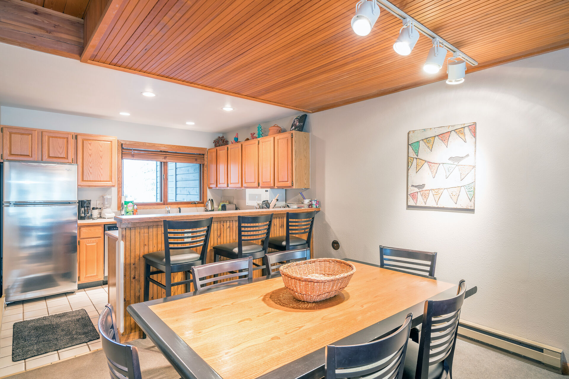 Dining room and kitchen with wood accents