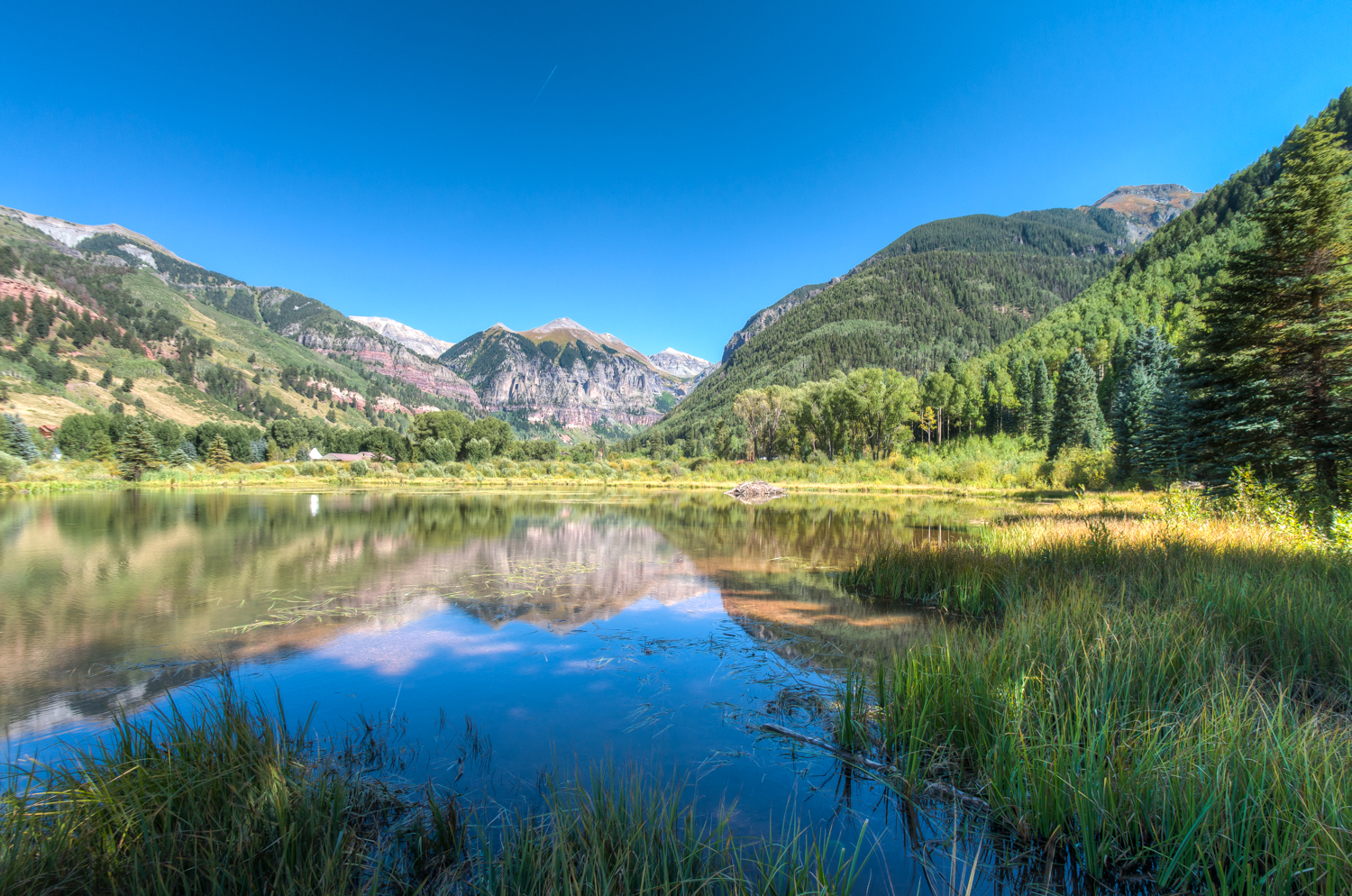 Beaver Pond view of mountain reflecting in water