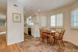 Breakfast nook opens into kitchen.