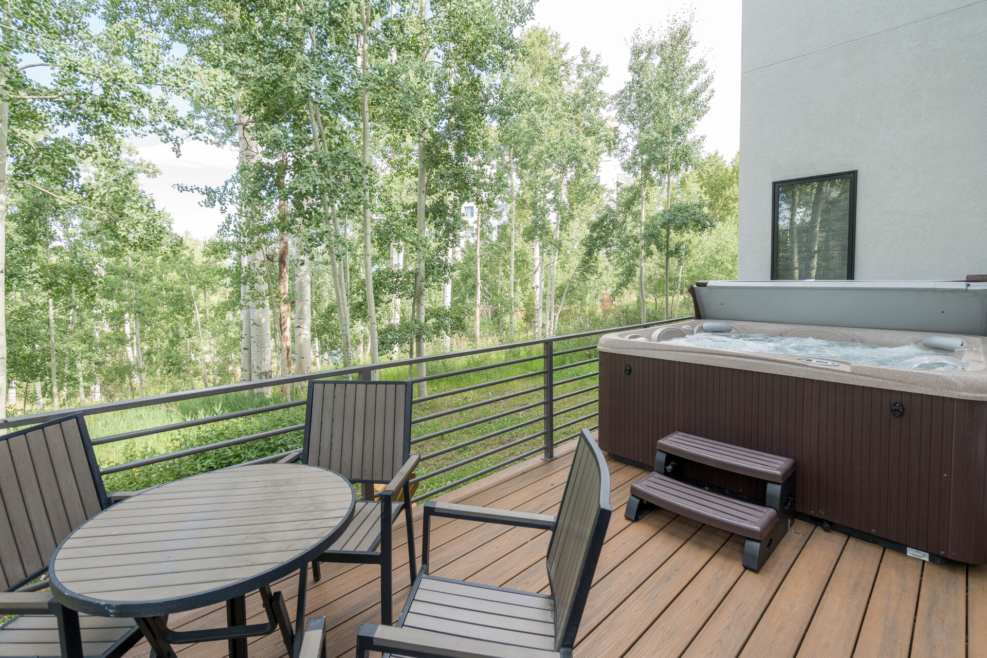 Deck with hot tub and outdoor seating