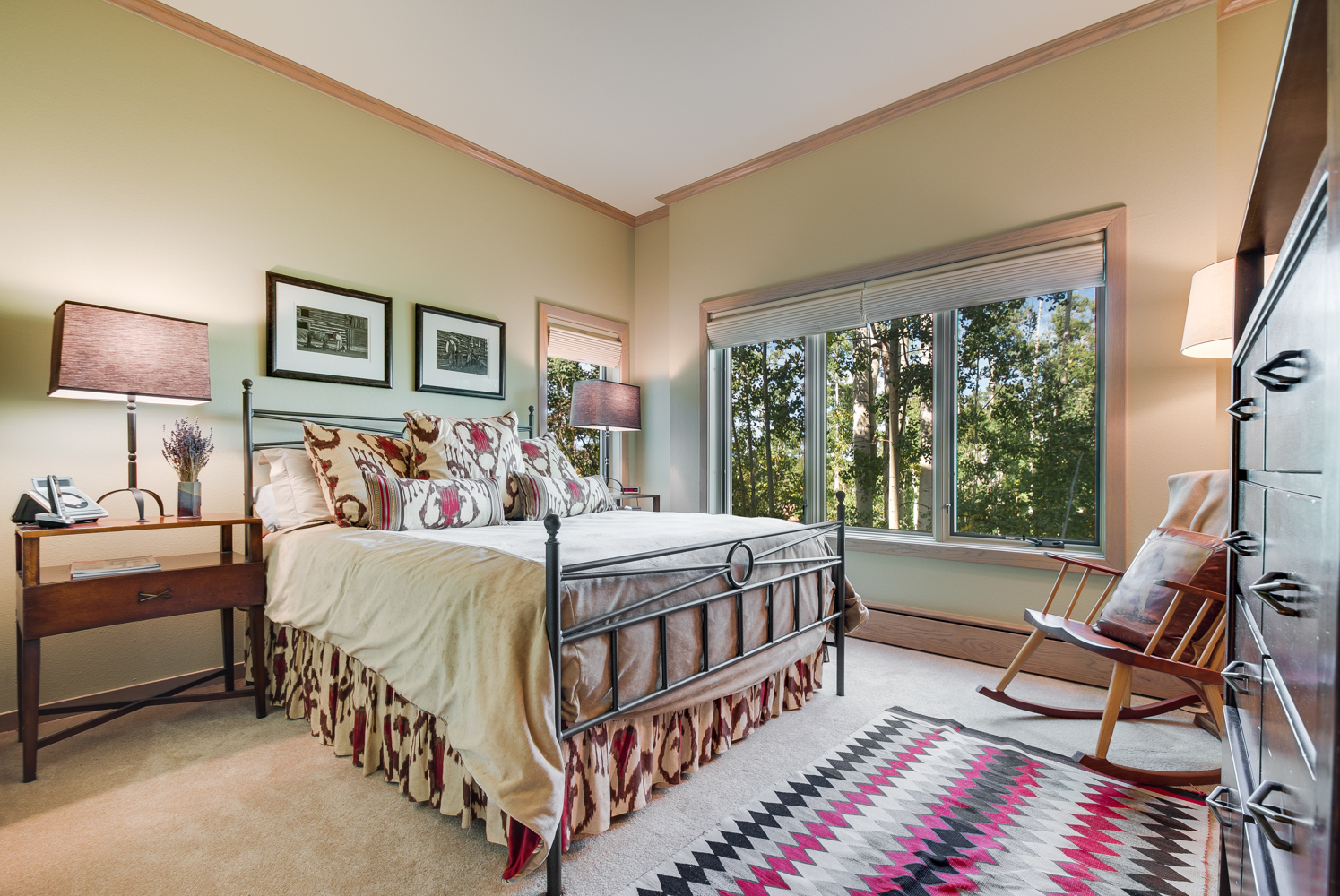 Bedroom with queen bed and rocking chair