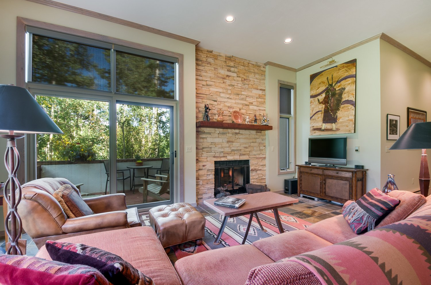 Living area with stone feature fireplace