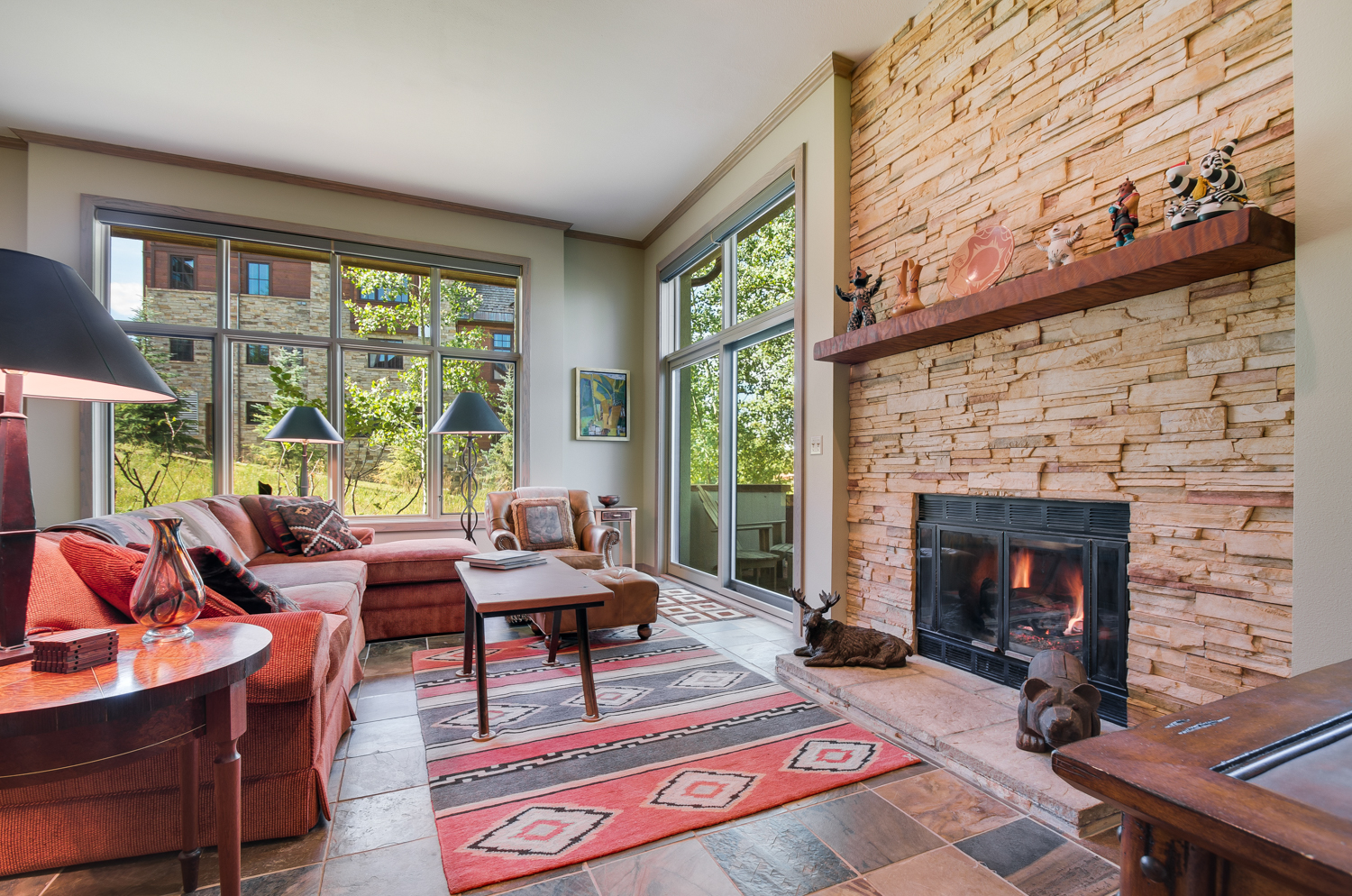 Living area fireplace with stone fireplace