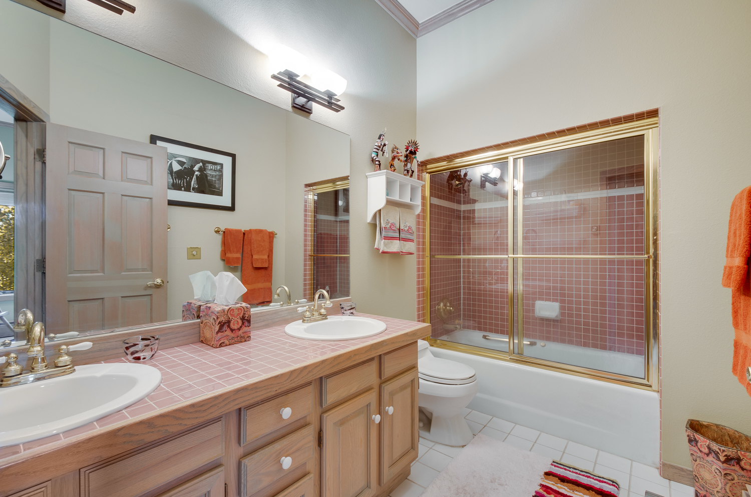 Master bathroom with tub and double vanity