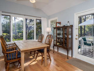 Dining table with seating for 4 and deck access