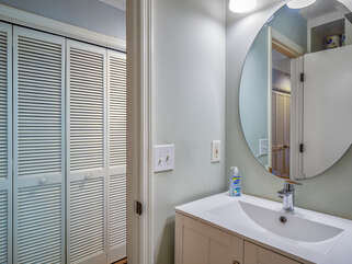 Updated guest bath is accessed from the hall