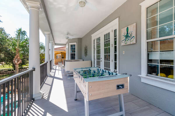 Large balcony overlooking the Watson golf course with outdoor Foosball