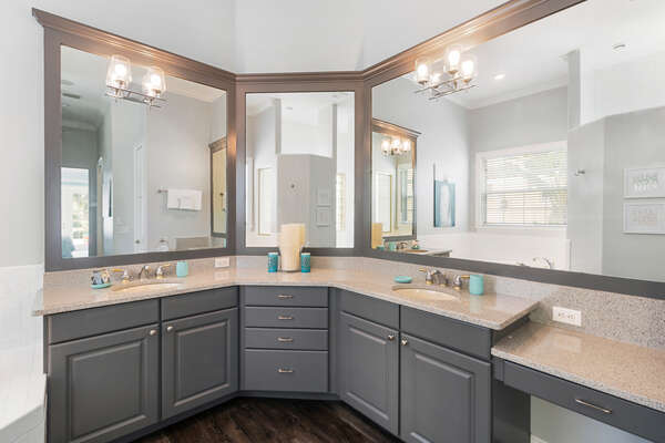 Large walk-in closet, shower, and his and hers sinks