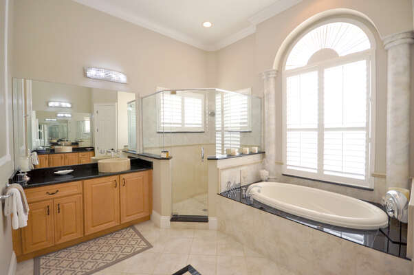 Separate walk-in shower area, his n hers double vanity units