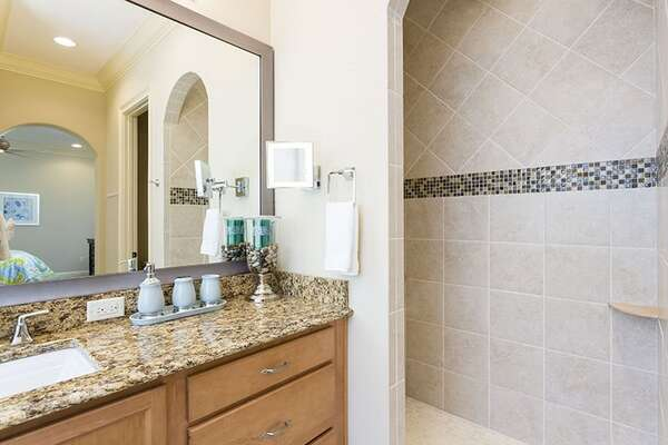 Walk into your shower or soak in the large bathtub