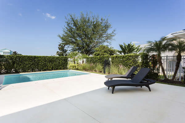 Enjoy relaxing with friends and family by your pool in lounge chairs