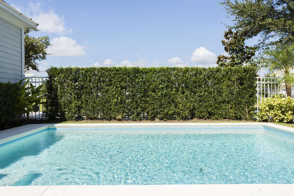 The landscaping offers privacy to your own personal oasis