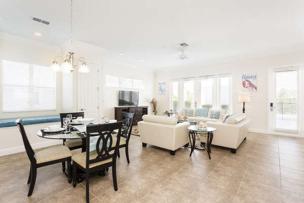 The dining area offers seating for 4 with an open concept into the living room