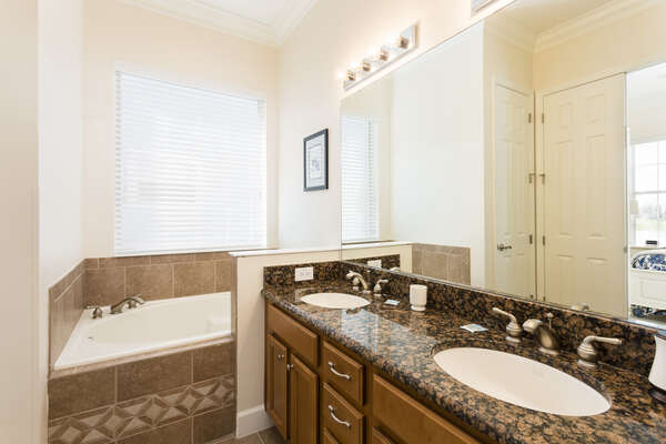 The master bathroom has a large tub to soak the day away