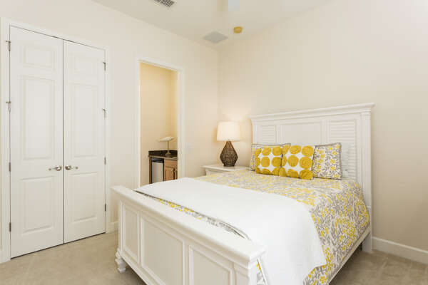 The second master bedroom is large with a queen bed and other amenities