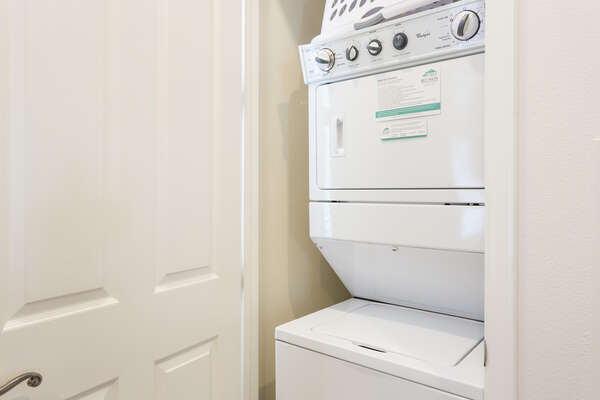 A stacked washer and dryer are located in the home for your use