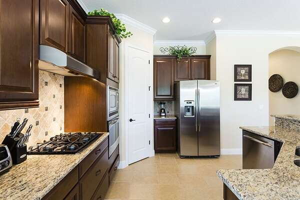 The kitchen offers plenty of space and also a walk in pantry