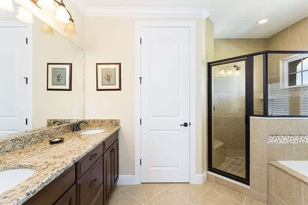 Upstairs main master bathroom with two sinks, garden tub walk-in shower