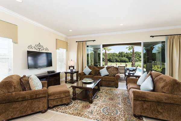 Step inside luxury with the beautiful living room offering views of the golf course
