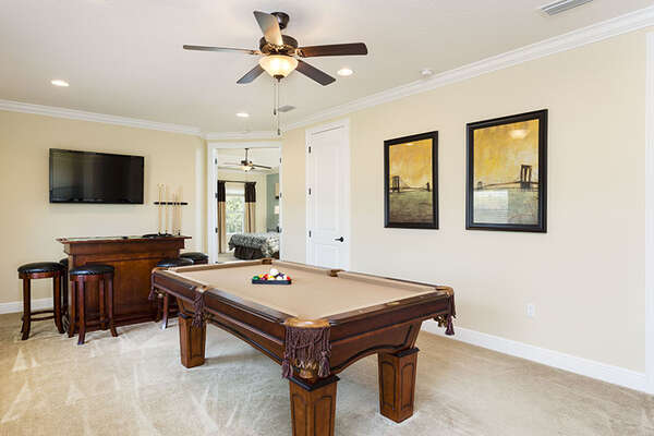 Enjoy the game room with pool table