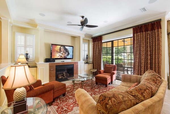 Grand living area with LCD TV, surround sound, fire place and direct pool access