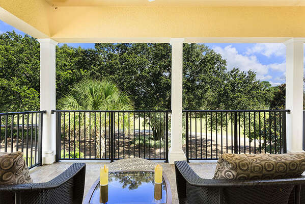 Enjoy warm breezes and views of the Tom Watson golf course on the balcony with luxury outdoor furniture