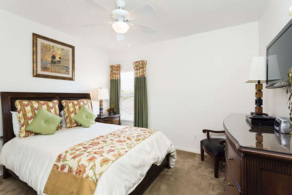 Queen bed with wall mounted TV
