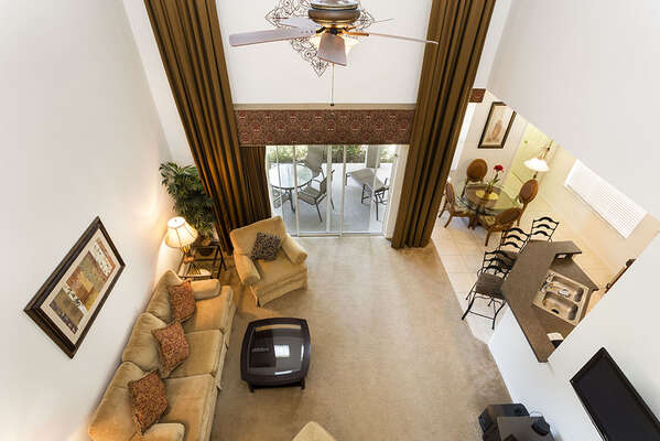 Upgraded ceiling fan and stylish window treatments.