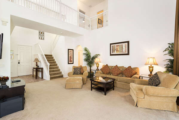 Spacious Living area with high vaulted ceiling
