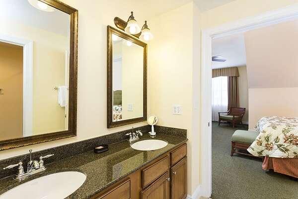 Shared bathroom with dual vanity