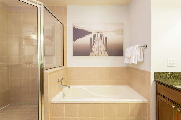 Ensuite bathroom with large soaking tub and walk in shower