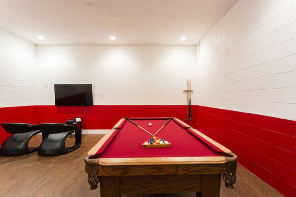 The Pool Table in the game room converts into a Ping Pong Table.