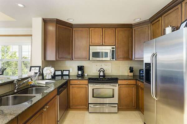 Kitchen with granite work tops and high end appliances