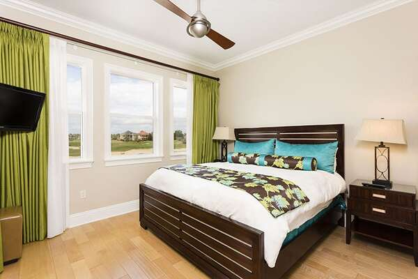 Queen size bed and wall mounted TV