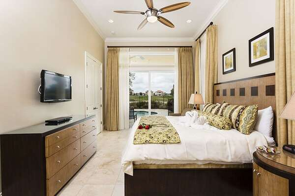 Downstairs Master Bedroom with King Bed and access to pool deck.