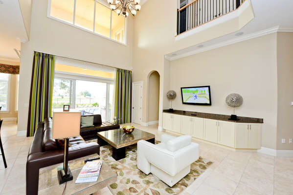 Open plan living area with access to the lanai & pool deck.