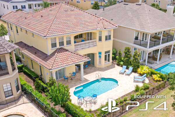 Aerial shot of the rear of the home showing the spacious pool deck