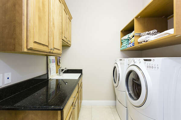 Laundry room with high end washer and dryer