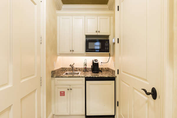 The guest suite boasts a kitchente with granite countertops, fridge, microwave and coffee maker