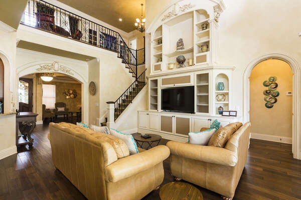 Grand living area with SMART TV, surround sound, and direct pool access