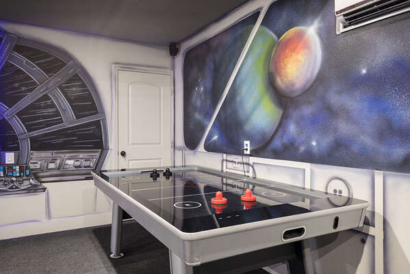There is also an air hockey table