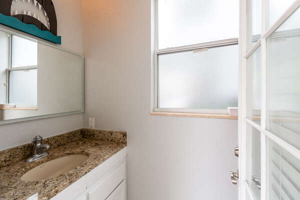 There is an outside shower as well as a bathroom for your convenience